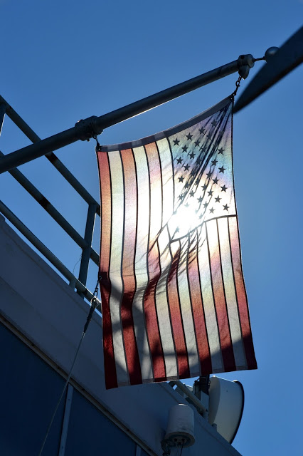 American flag at the top of the Empire State Building