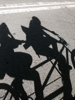 Shadow of us on a tandem bike