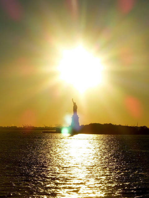 The Statue of Liberty in the sunset