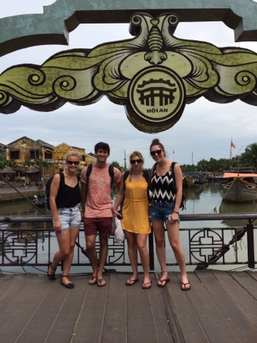 The four of us on a bridge in Hoi An