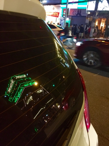 Lights reflected in a car