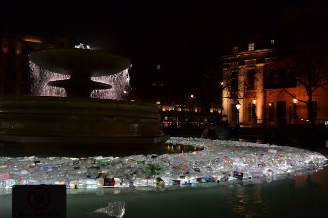 Lit bottles in the water fountain at Trafalgar Square