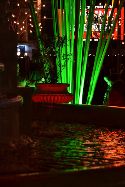 Green and red lights reflected in the water