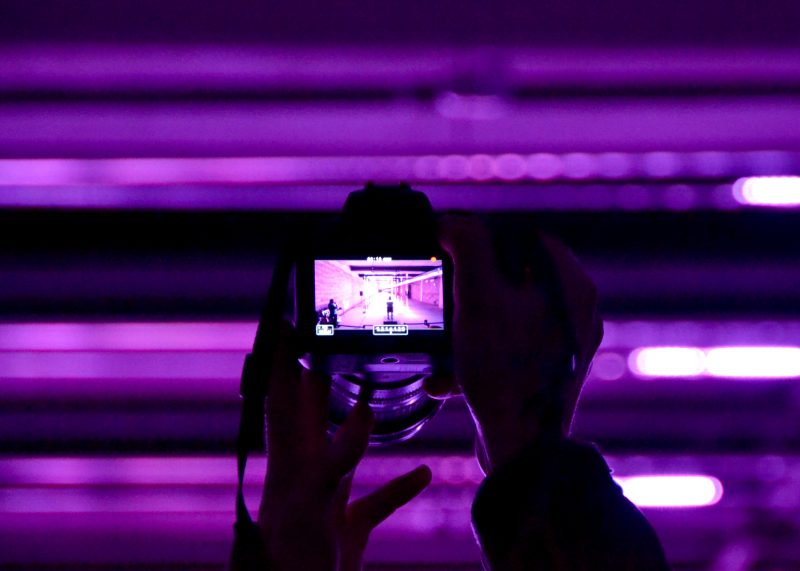 Someone photographing the lights
