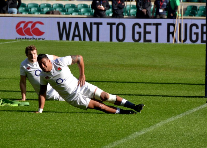Joe Launchbury working his core with Nathan Hughes