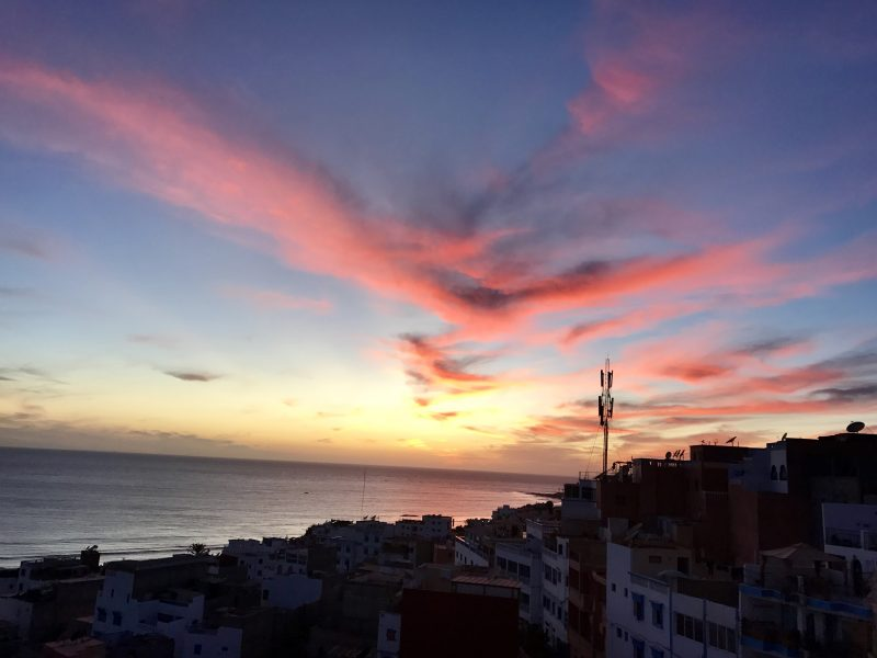 Pink and purple sunset from a rooftop in Taghazout