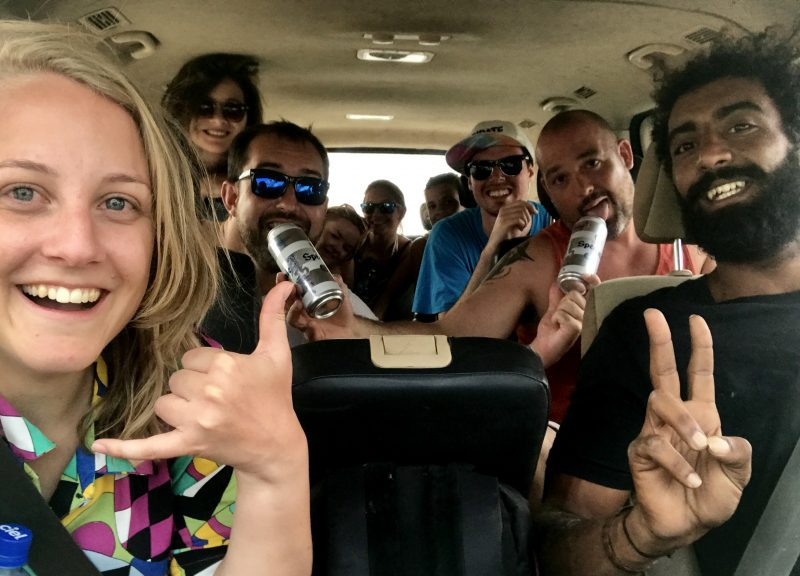 the group in the van with beers after a day surfing