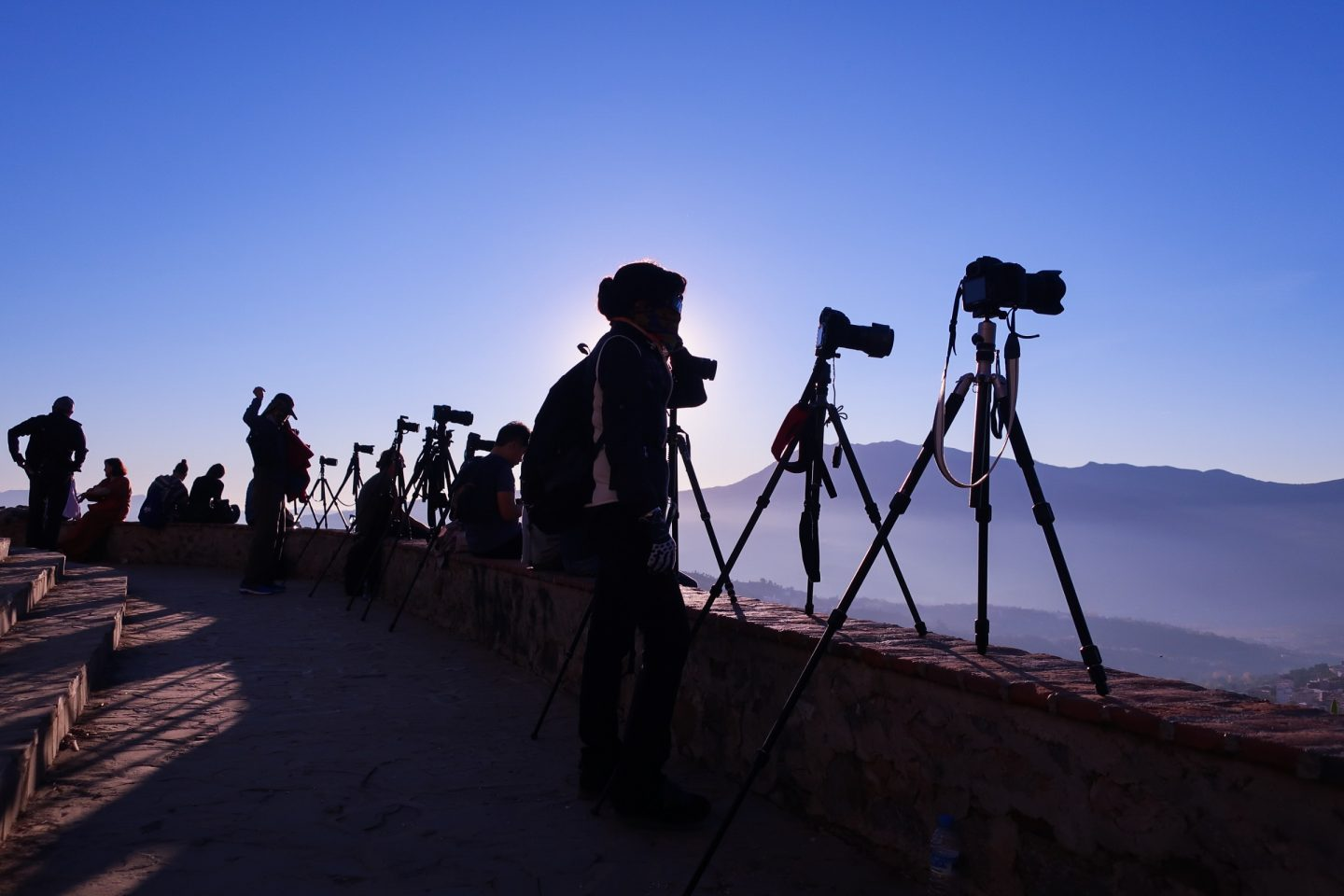 silhouettes of photographers and their tripods, set up for the sunset by the Spanish mosque, overlooking Chefchaouen