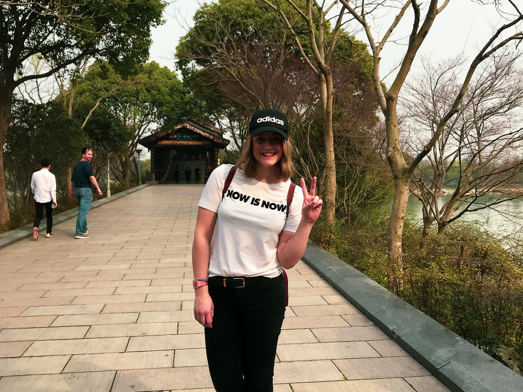 Sarah standing near Chinese temple in Wuxi, China
