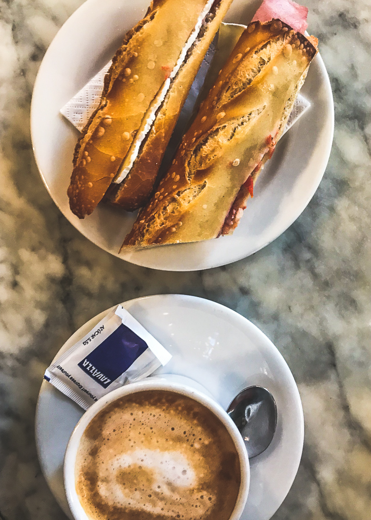 where to eat in Barcelona: Ham and cheese sandwich and a coffee