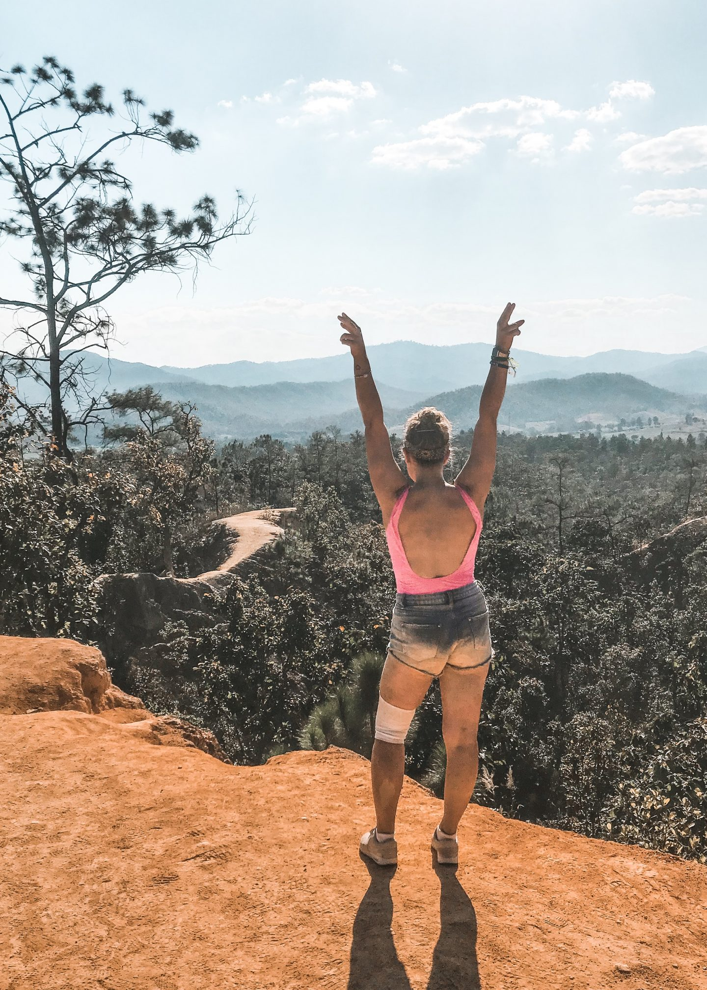 Hands in the air with Pai Canyon in view, explore pai