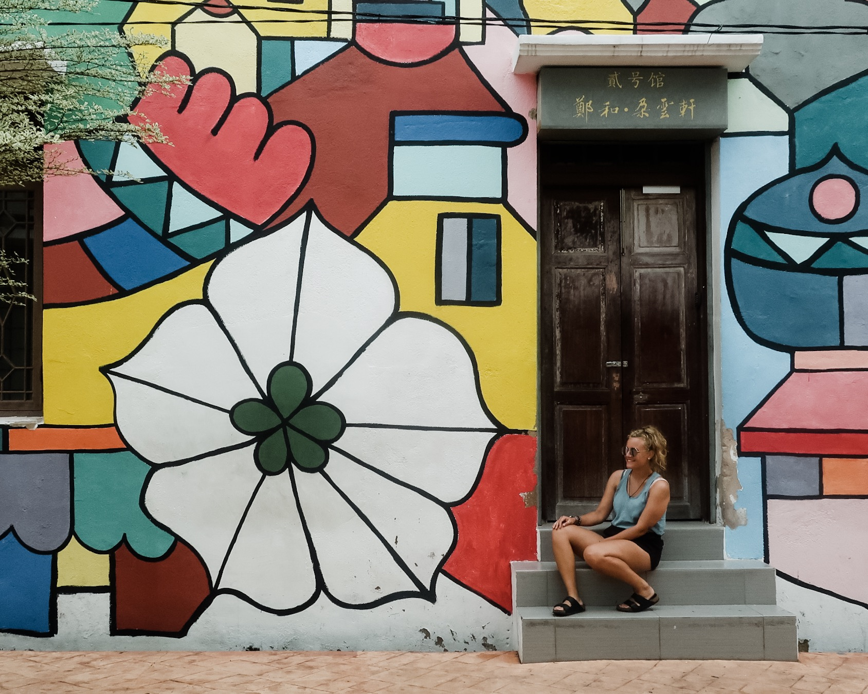 Things to do Melaka: Sat with some colourful street art in Melaka