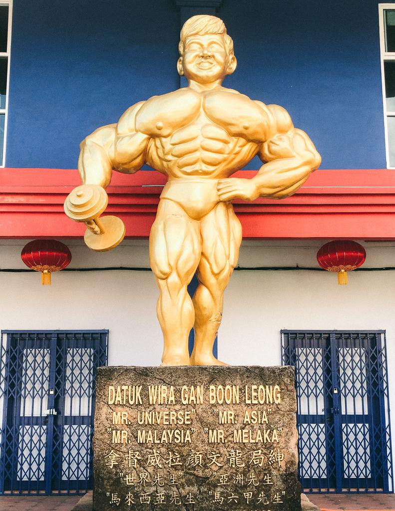 Things to do Melaka: The huge body builder statue outside the gym