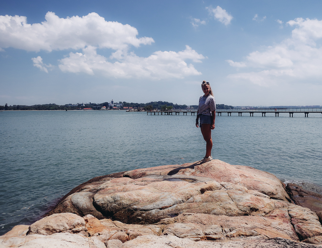 Singapore to do: me with the water and jetty behind