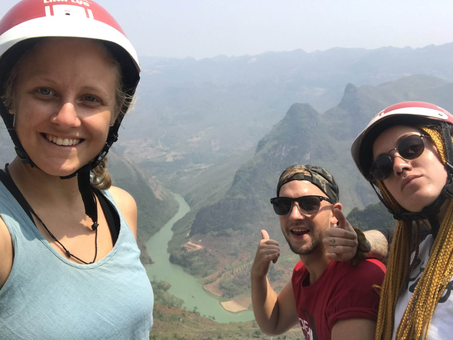 Hà Giang Loop: three of us overlooking the mountains and river