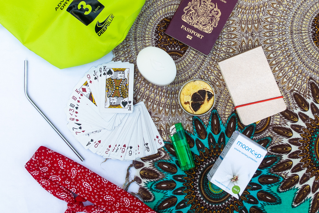 what should you take travelling: a flatly of playing cards, notepad, bandana, moon cup, dry bag and soap