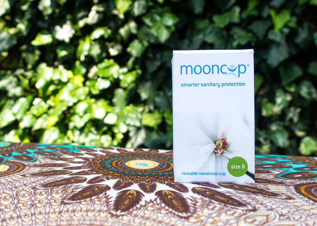 Mooncup box against a leafy background
