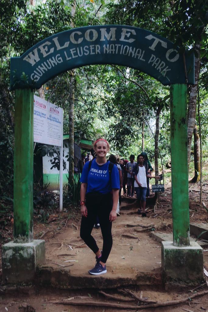 I'm stood under the sign for the Gunung Leuser National park