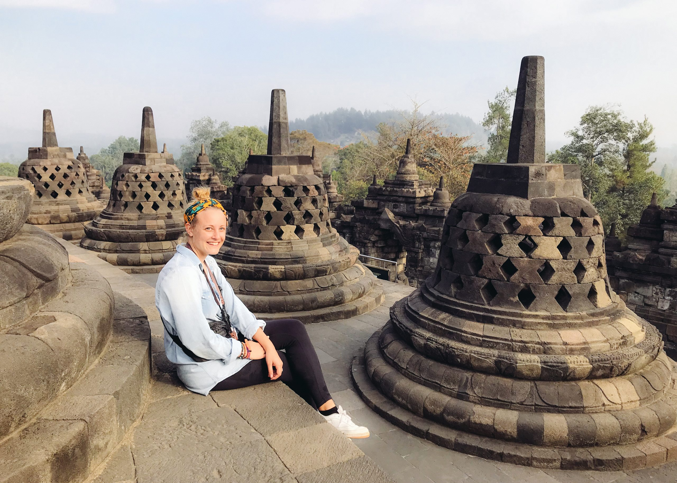Sarah the Borobodur temple complex with bell shaped stupors