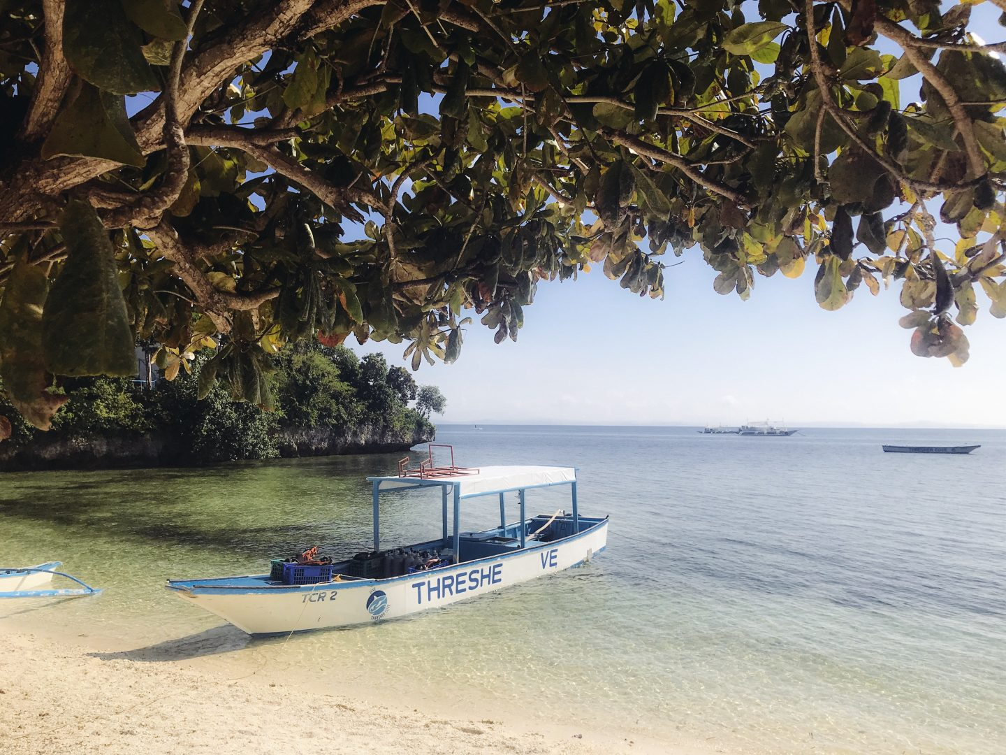 The small dive boat on the private beach in Malapascua