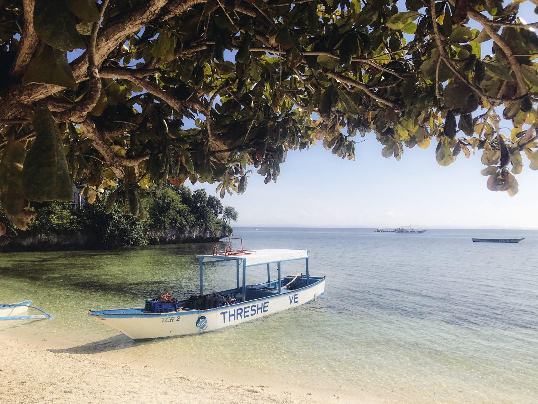 The small dive boat on the private beach in Malapascua