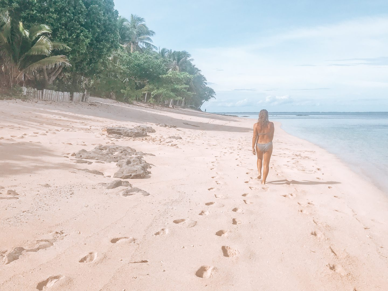 Walking down an empty beach