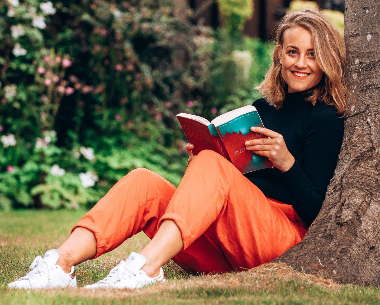 Shantaram Review - Sarah under the tree reading