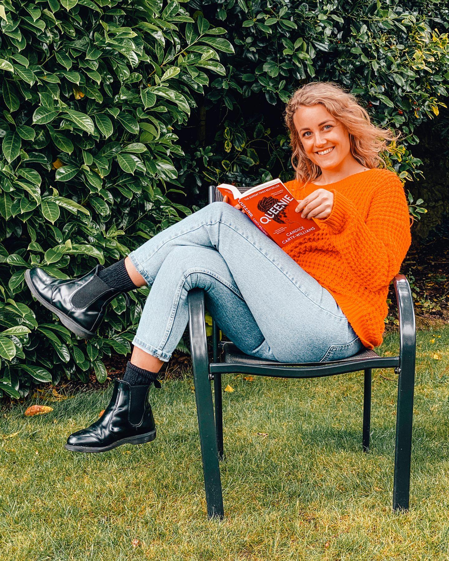Sarah reading queen in the garden