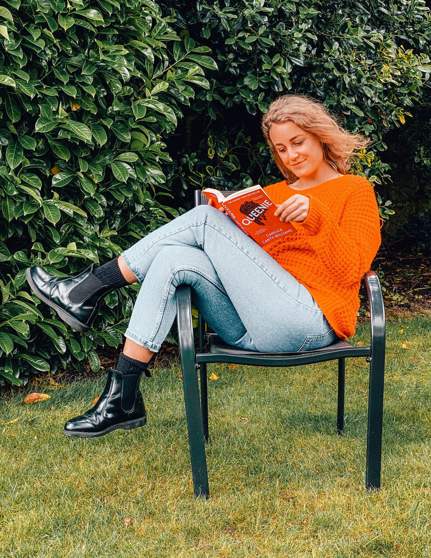 Sarah reading Queenie in the garden