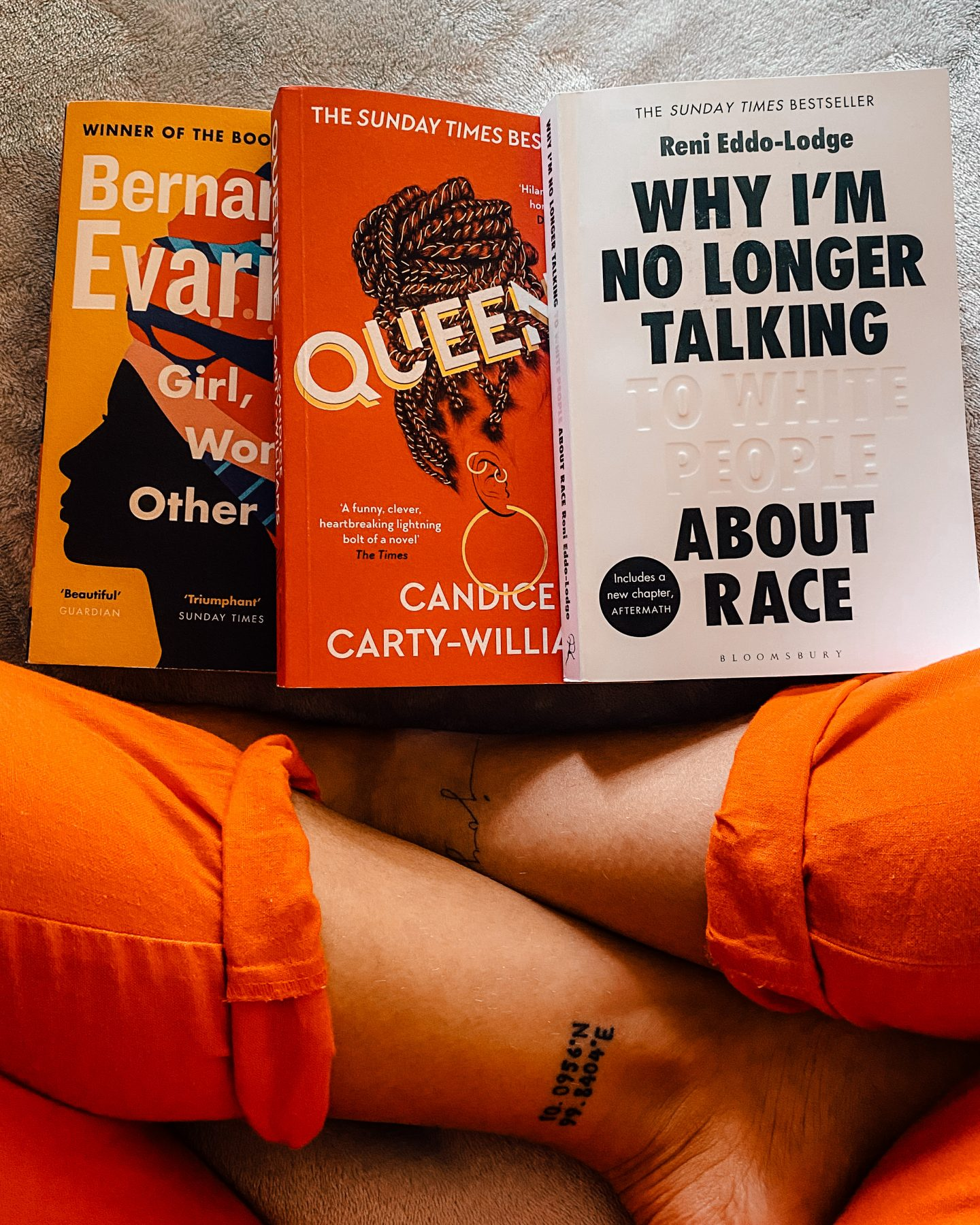 Girl, Woman, Other, Queenie and Why I'm no longer talking about race - books and my sat cross legged.