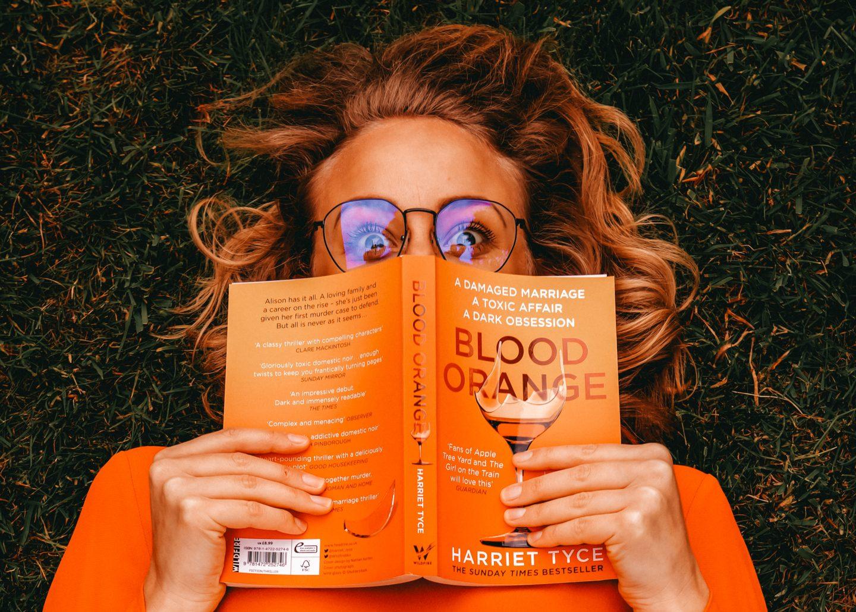 Sarah hides cheekily behind the blood orange book